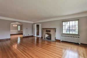 living room with hardwood floors in tudor house