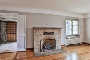 original stone fireplace in old tudor style house